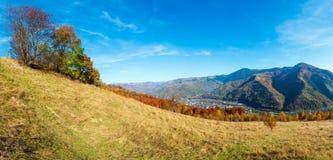 Autumn Carpathian mountain, Rakhiv, Ukraine. Autumn Carpathian Mountains high-resolution panorama landscape with multicolored  trees on slope and  Rakhiv town Stock Image