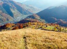 Autumn Carpathian mountain, Rakhiv, Ukraine. Autumn Carpathian Mountains landscape with multicolored yellow-orange-red-brown trees on slope and Rakhiv town and royalty free stock photo