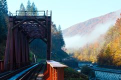 Autumn Carpathian mountains, railroad bridge and river, Ukraine Royalty Free Stock Image