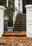 Autumn Carpeting. Autumn leaves carpet the entrance to a private home in London Royalty Free Stock Images
