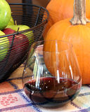 Autumn Celebration - Red Wine, Pumpkins, and Apple stock images