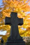 Autumn cemetary cross Stock Images