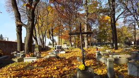 Autumn at a cemetery. Fall at a graveyard, old orthodox cemetery in Eastern Europe, warm autumn sunshine stock footage