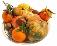 Autumn centerpiece with pumpkins chestnuts and ripe oranges Royalty Free Stock Image
