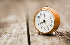 Autumn change time, daylight savings concept. Orange retro alarm clock, background royalty free stock image