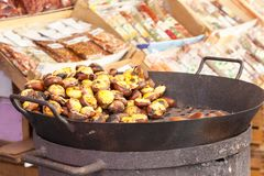 Autumn chestnuts roasting over an old charcoal burner Royalty Free Stock Photos