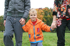 Autumn child with family Stock Photography