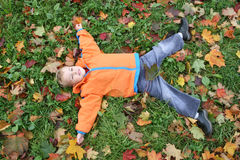 Autumn child lies Royalty Free Stock Photos