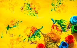 Autumn childrens drawings with colorful paints, yellow background. Autumn childrens drawings with colorful paints on a yellow background stock images
