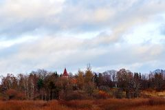 In the autumn the church tower. A beautiful autumn view with the church tower Stock Image