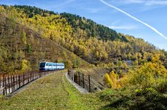 Autumn on the Circum-Baikal Road to the south of Lake Baikal. With train Royalty Free Stock Image