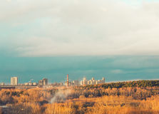 Autumn city on the horizon. Landscape of Ekaterinburg city behind autumn forest Royalty Free Stock Image