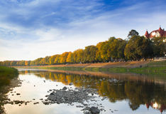 Autumn city landscape with reflection in the river Royalty Free Stock Photo