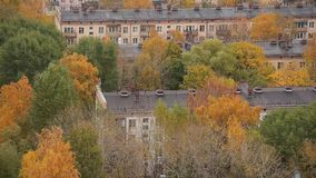 Autumn in the city. Multicolored trees. Houses Fall colors. Autumn in the city. Multicolored trees. Houses with windows. Five-story building. Fall colors.Float stock footage