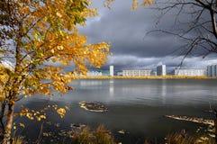 Autumn city park. Yellow foliage and blue lake Royalty Free Stock Photo