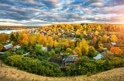 Looking at Plyos from a height. Autumn city of Plyos from the height of the Cathedral Mountain, houses and yellow trees and Volga in the distance stock photography