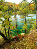 Autumn cliff view of Pink Lake Gatineau Park. View of Pink Lake from cliffside portion of Trail in Gatineau Park, Quebec, Canada Royalty Free Stock Photo