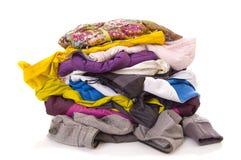 Autumn Clothes. Heap of clothes on white background Stock Photos