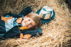 Autumn Clothing and color kids trends. Boy on a breeze in an autumn village. Autumn child boy with autumnal mood. Advertisement concept royalty free stock images