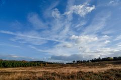 Autumn cloud formation against blue sky over Cannock Chase. Cannock Chase Area of Outstanding Natural Beauty in Staffordshire. 26 squared miles of forest and Stock Photo