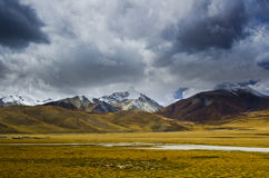 Autumn cloud and Snow-capped mountains Royalty Free Stock Photo