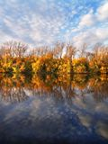 Autumn clouds. Sunny autumn view about river Stock Photography