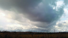 Autumn clouds over the field. Time Lapse. Video stock footage