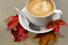Autumn Coffee Latte with Orange and Red Fall Leaves Stock Photos