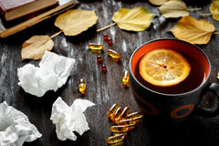 Autumn cold - treatment with hot tea and medecine Royalty Free Stock Photos