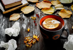Autumn cold - treatment with hot tea and medecine Stock Photos