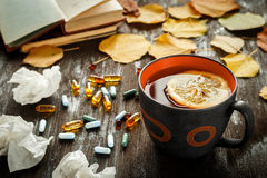 Autumn cold - treatment with hot tea and medecine Stock Image