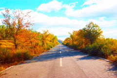 Autumn color highway Stock Images