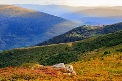 Autumn color  illusion in mountain landscape by sunlight Stock Photos