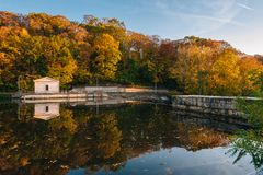 Autumn color at Lake Roland at Robert E Lee Park in Baltimore, Maryland.  stock image