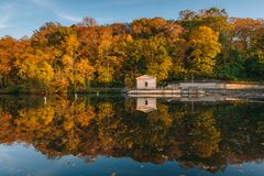 Autumn color at Lake Roland at Robert E Lee Park in Baltimore, Maryland.  stock photos
