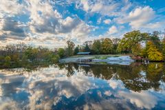 Autumn color at Lake Roland at Robert E Lee Park in Baltimore, Maryland.  stock photo