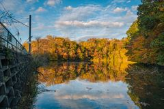 Autumn color at Lake Roland at Robert E Lee Park in Baltimore, Maryland.  stock photography