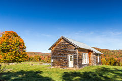 Autumn color and old barn in Vermont countryside. Royalty Free Stock Photo
