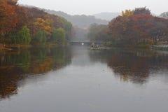 Autumn color on pond at Namsangol folk village, Seoul, South Korea - NOVEMBER 2013 Stock Photography