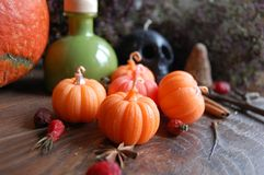 Orange pumpkin soy wax candles. Autumn-color pumpkin candles made of soy wax makes your home cozy. Pretty candles for the Halloween Stock Images