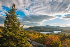 Autumn color and view of North-South Lake, from Sunset Rock, in the Catskill Mountains, New York.  stock photos