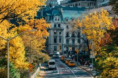 Autumn color and view of 84th Street in the Upper East Side, from Central Park, Manhattan, New York City.  stock photo