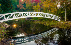 Autumn color and walking bridge over a pond in Somesville, Maine Royalty Free Stock Photos