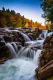 Autumn color and waterfall at Rocky Gorge, on the Kancamagus Hig Royalty Free Stock Photos