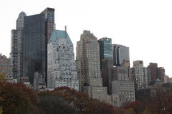 Autumn colored trees with buildings behind. Photo shot from inside Central Park in New York Stock Image