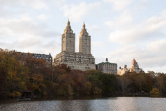 Autumn colored trees with buildings behind them. Photo shot from inside Central Park in New York Royalty Free Stock Photo