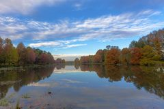 Autumn colored trees next to the pond stock photography