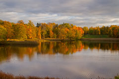 Autumn colorful foliage over lake with beautiful woods Royalty Free Stock Photos