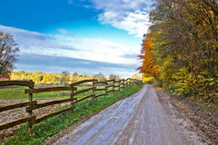 Autumn colorful mountain dirt road stock photo