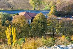 Autumn colorful trees and country house. Seasonal natural scene. Vibrant colors Royalty Free Stock Images